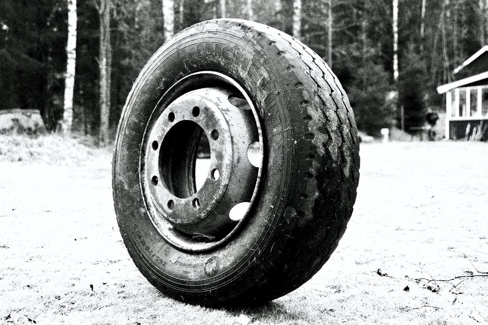 black wheel tire on gray concrete ground