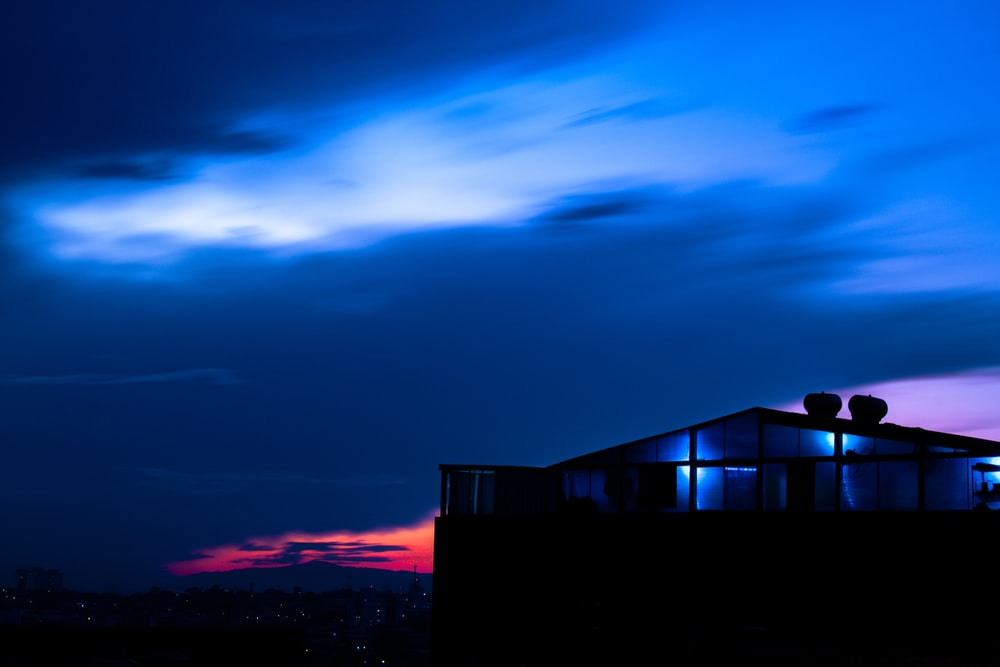 silhouette of house during sunset
