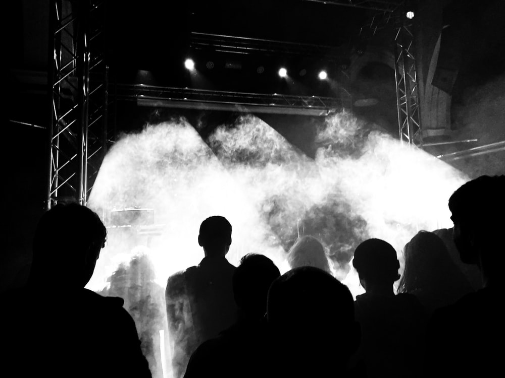 silhouette of people standing on stage