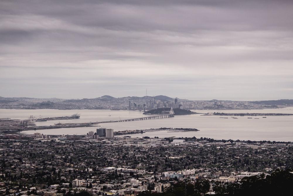 city skyline near body of water during daytime