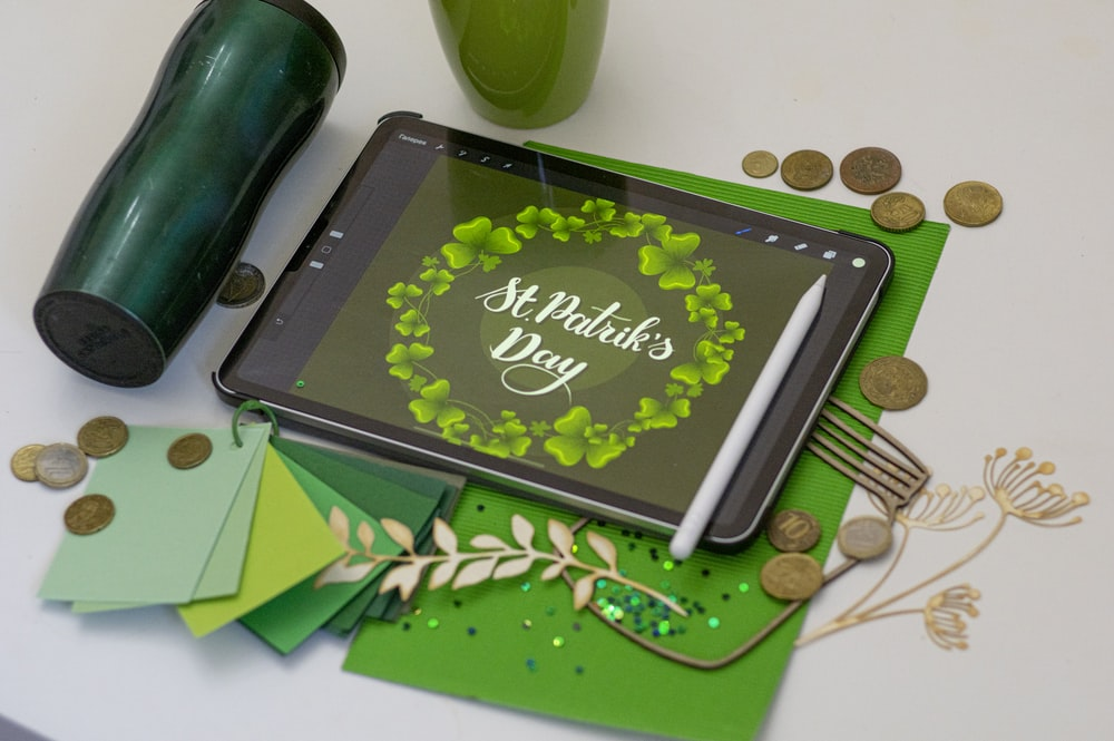 black tablet computer on green table