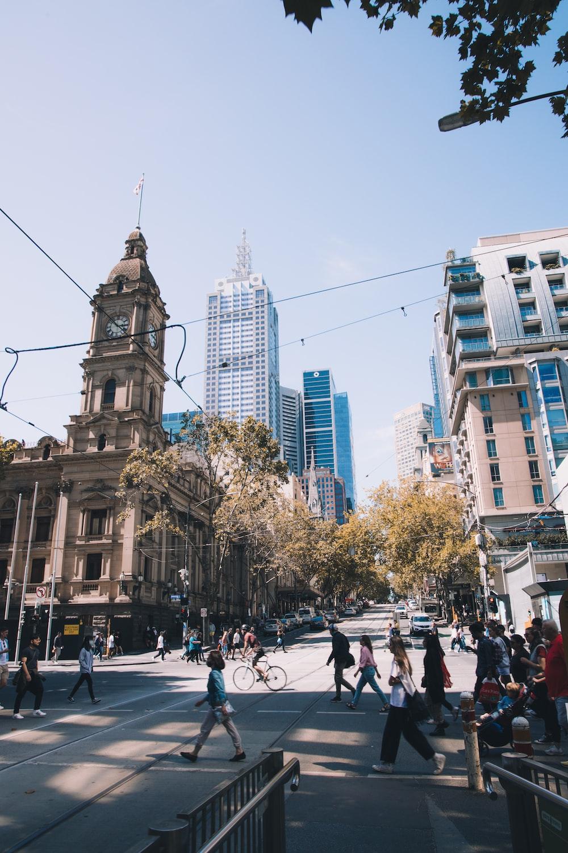 people walking on street near brown concrete building during daytime