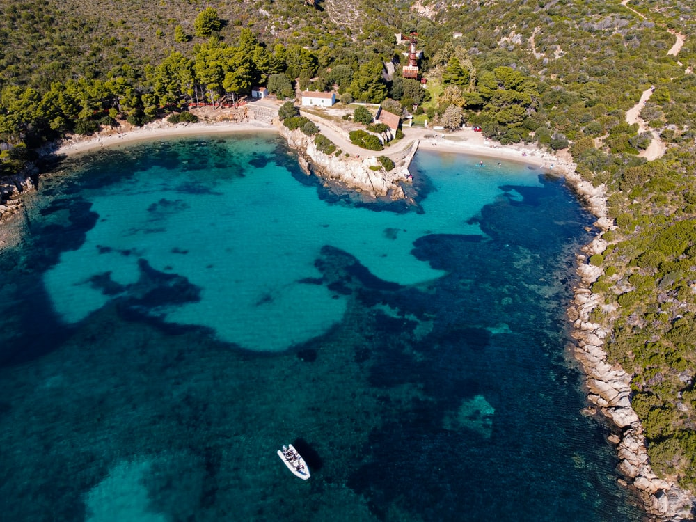 aerial view of white boat on blue sea during daytime