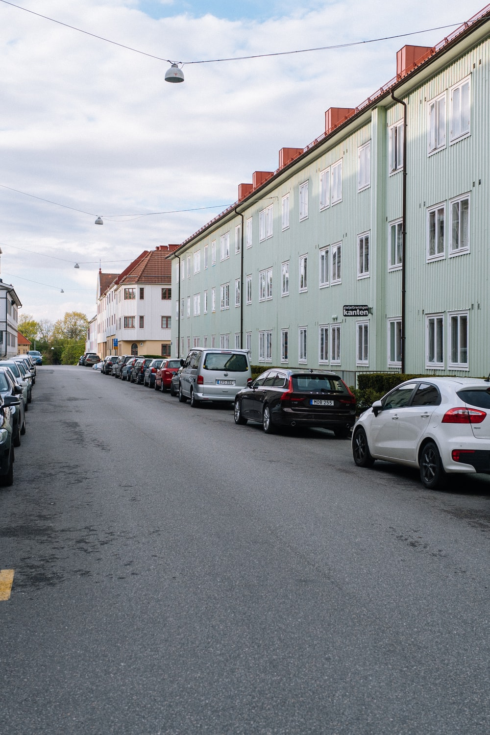 cars parked in front of building during daytime