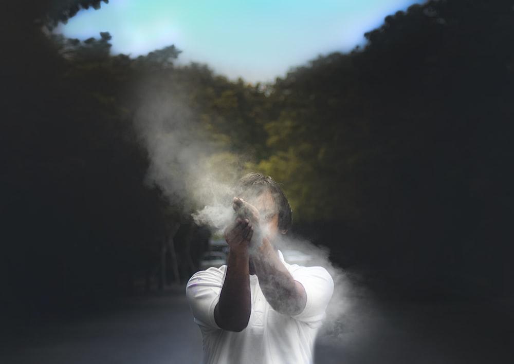 man in white t-shirt smoking
