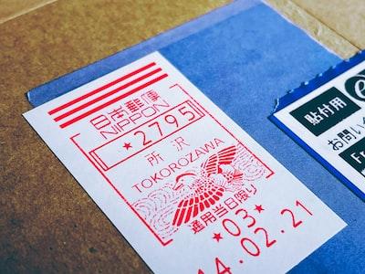 Tokorozawa white and red card on blue textile