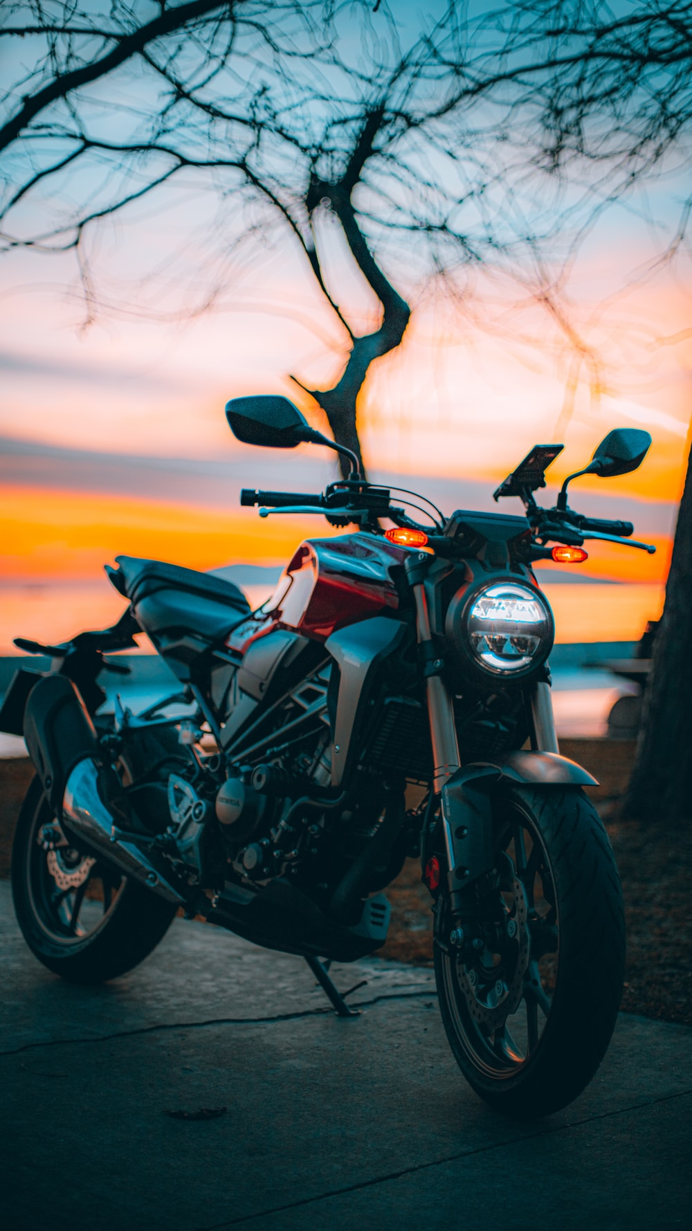 black and gray motorcycle during sunset