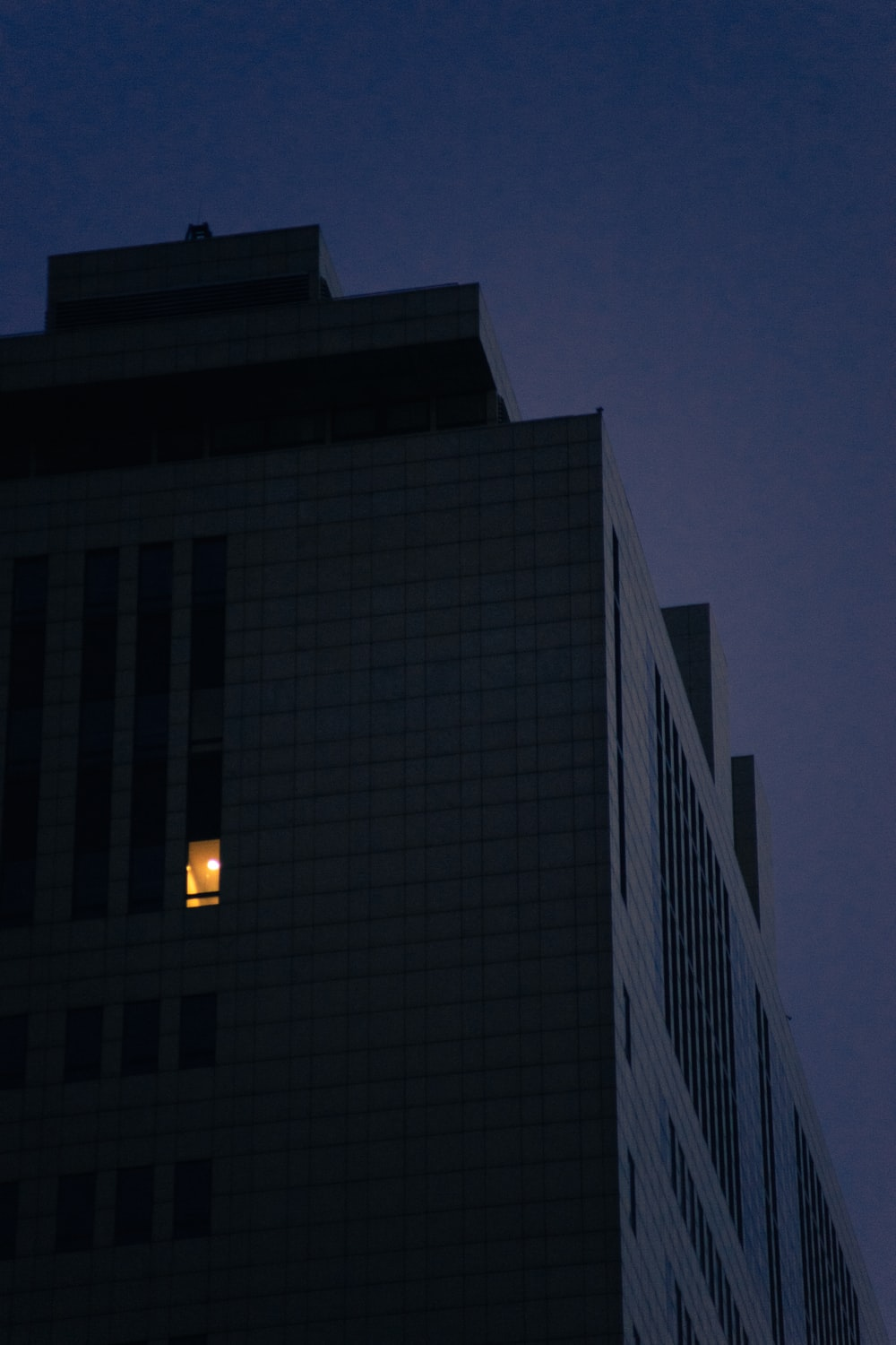 gray concrete building during night time