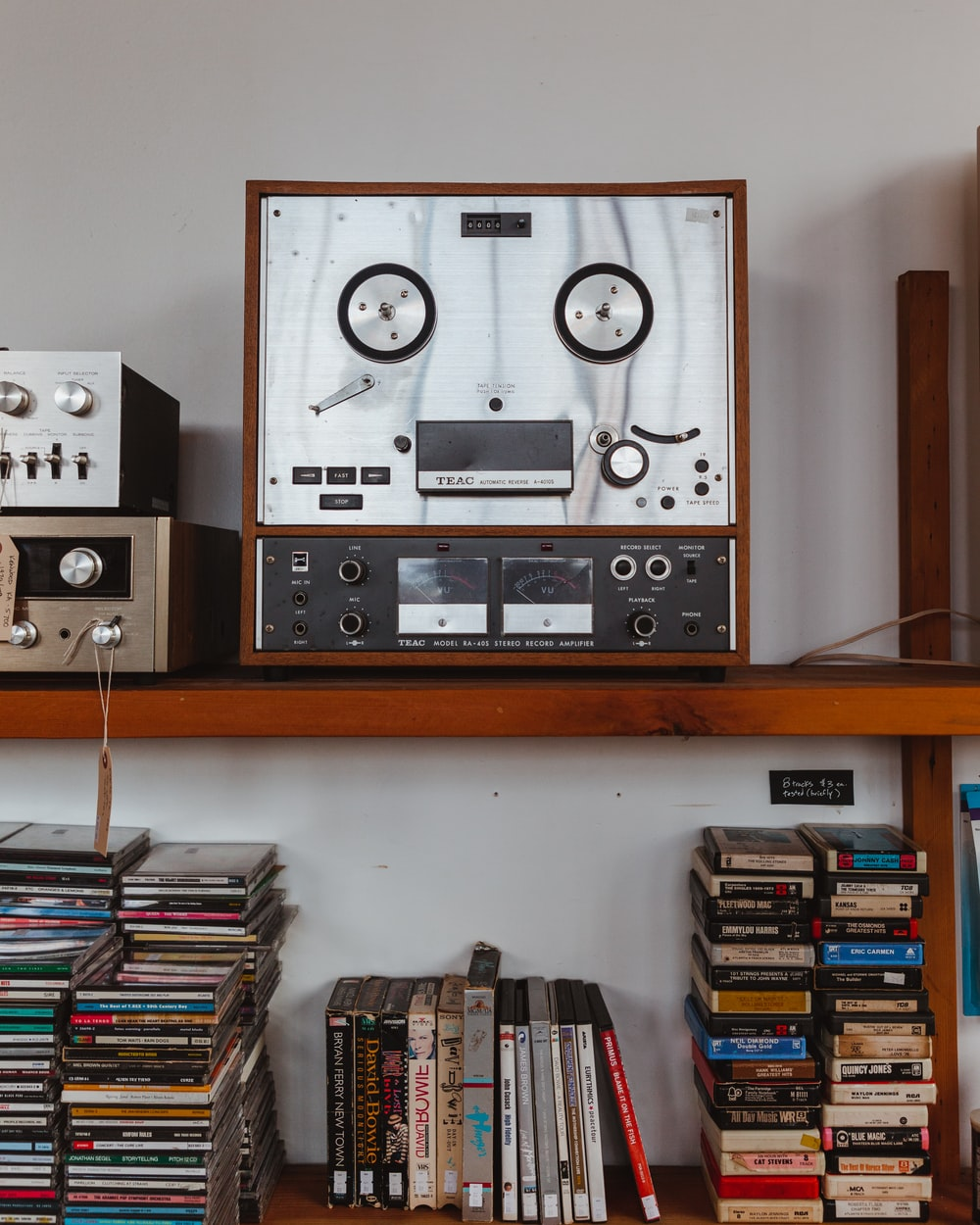 gray and black audio component on brown wooden shelf