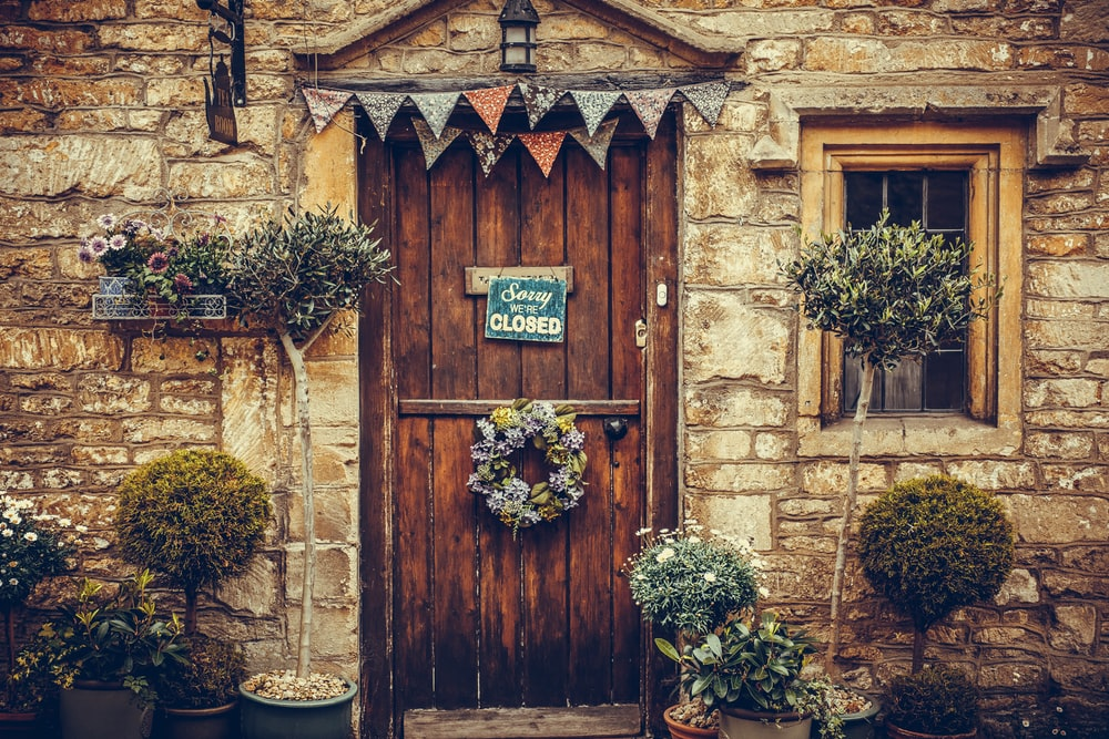 brown wooden door with flowers