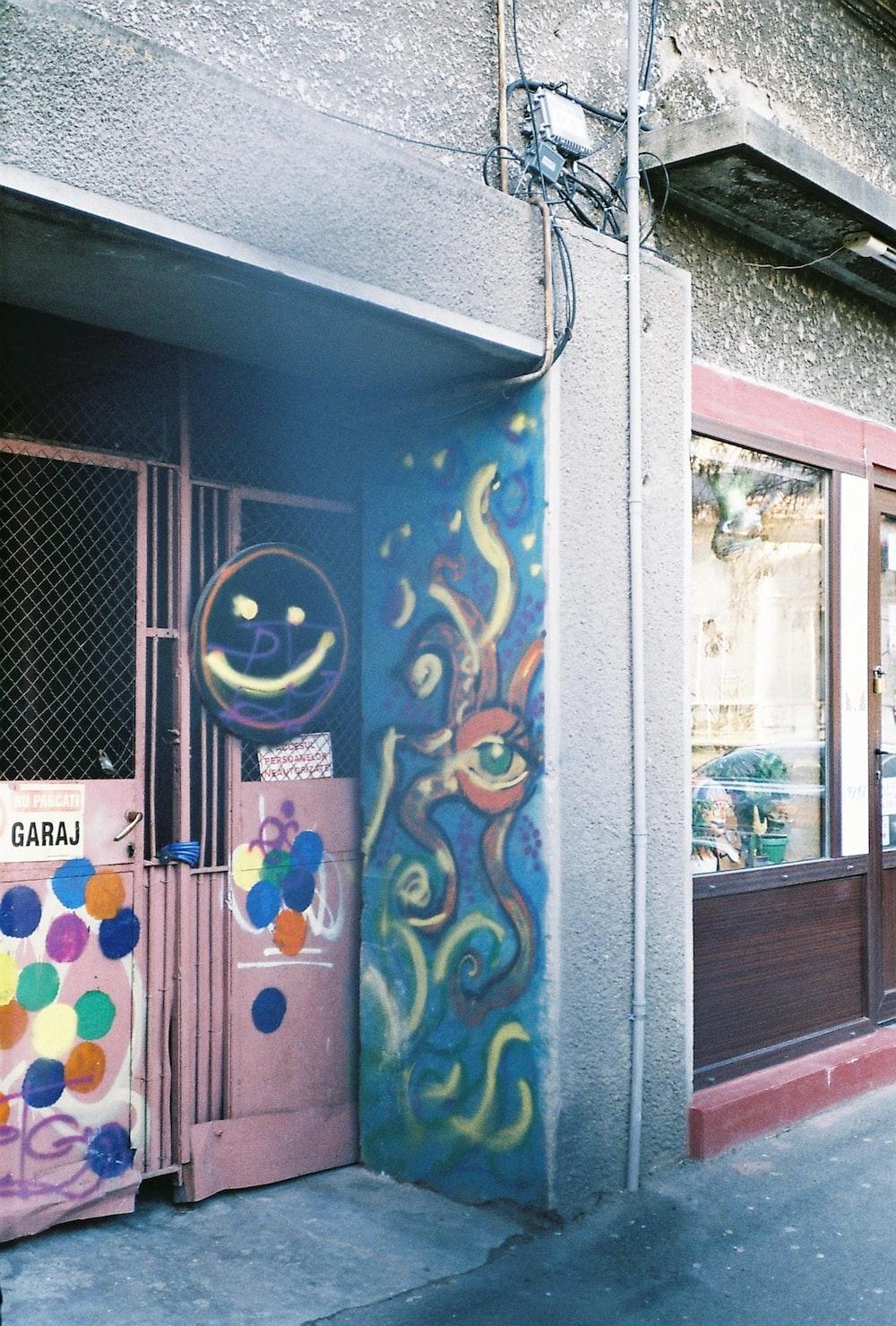 blue and yellow graffiti on wall