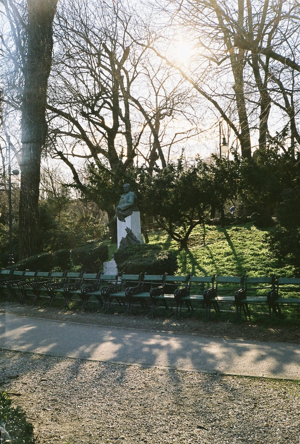 white statue in the middle of the park