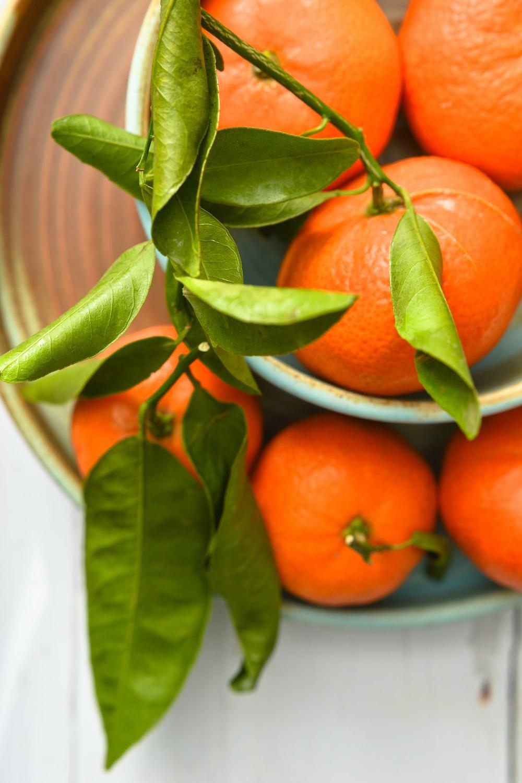 orange fruit on white ceramic bowl