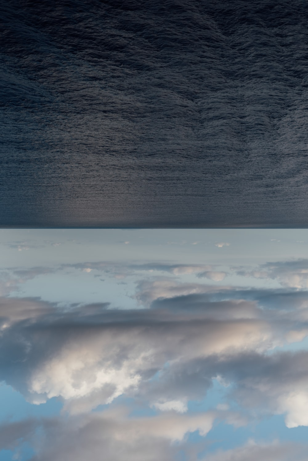 white clouds over body of water