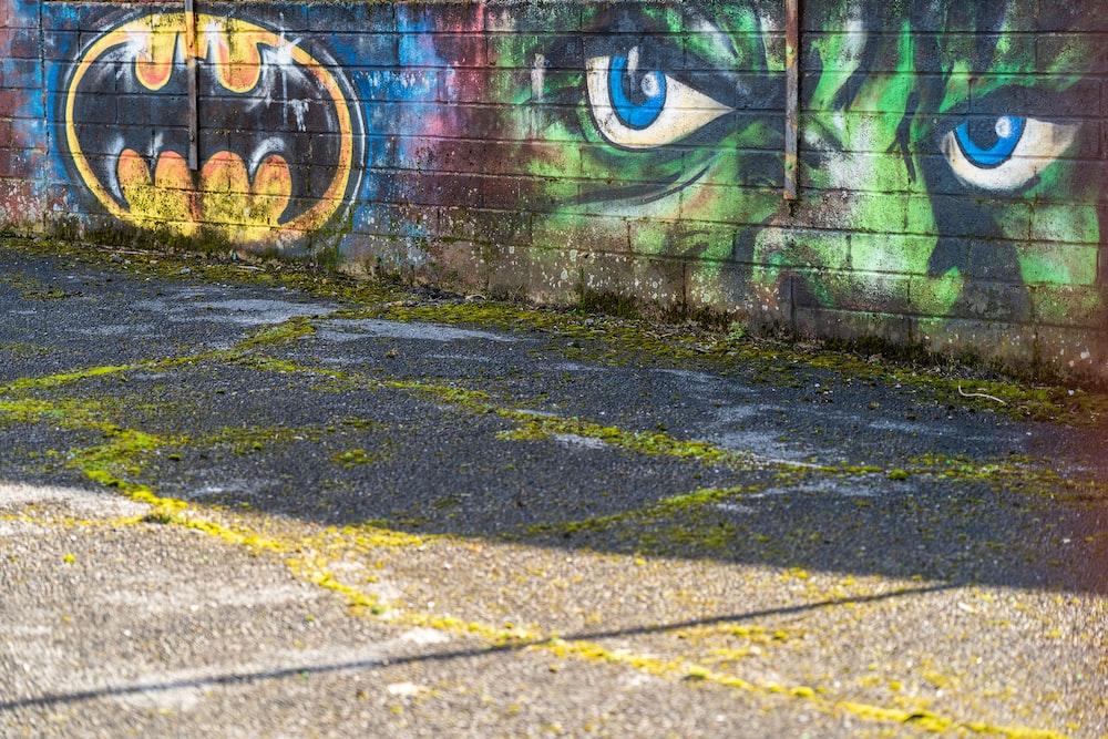 blue and white graffiti on wall