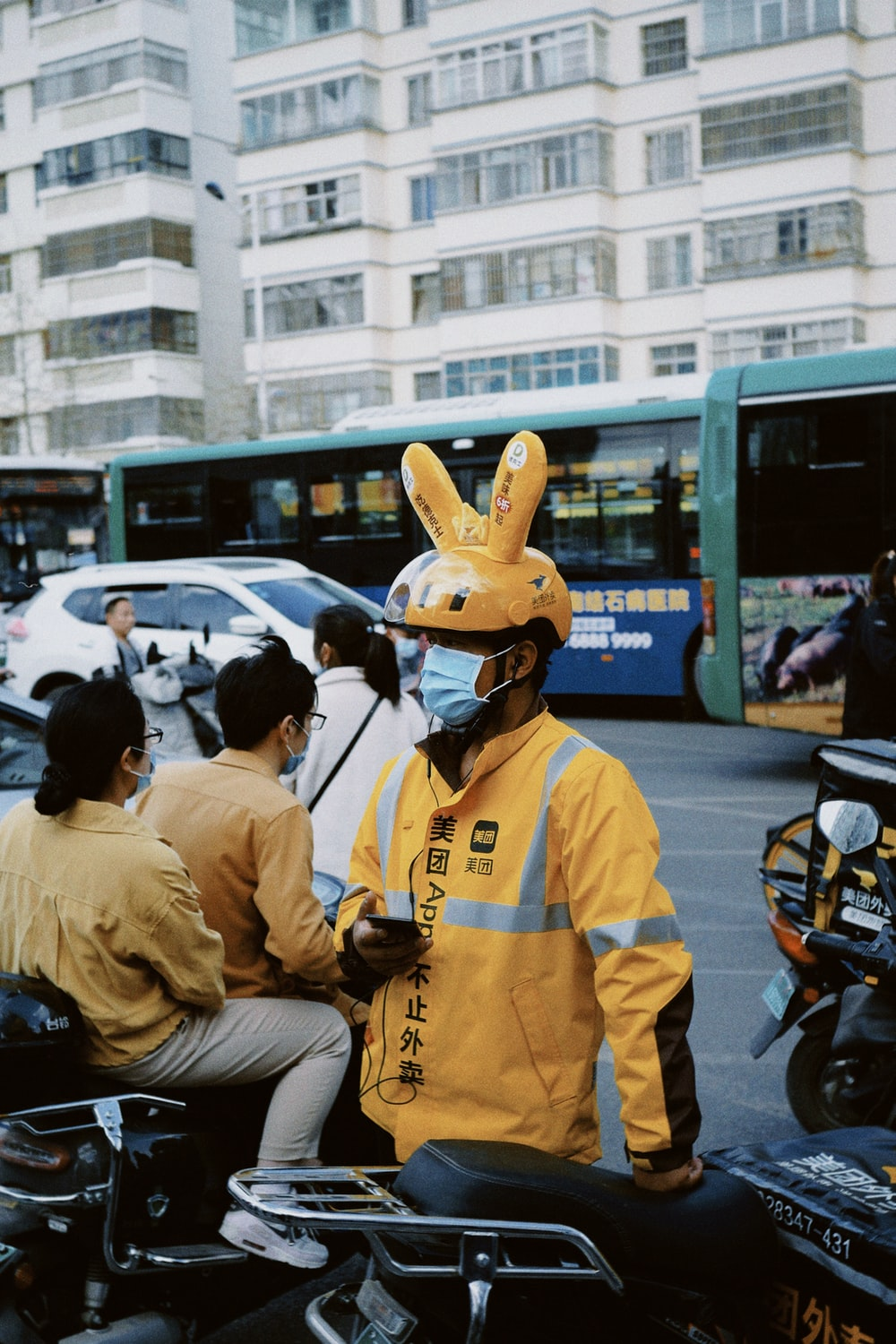 people in yellow and white uniform riding motorcycle during daytime