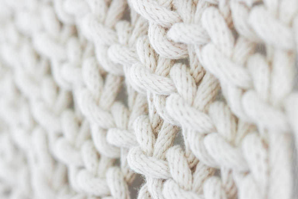 white knit textile on brown wooden table