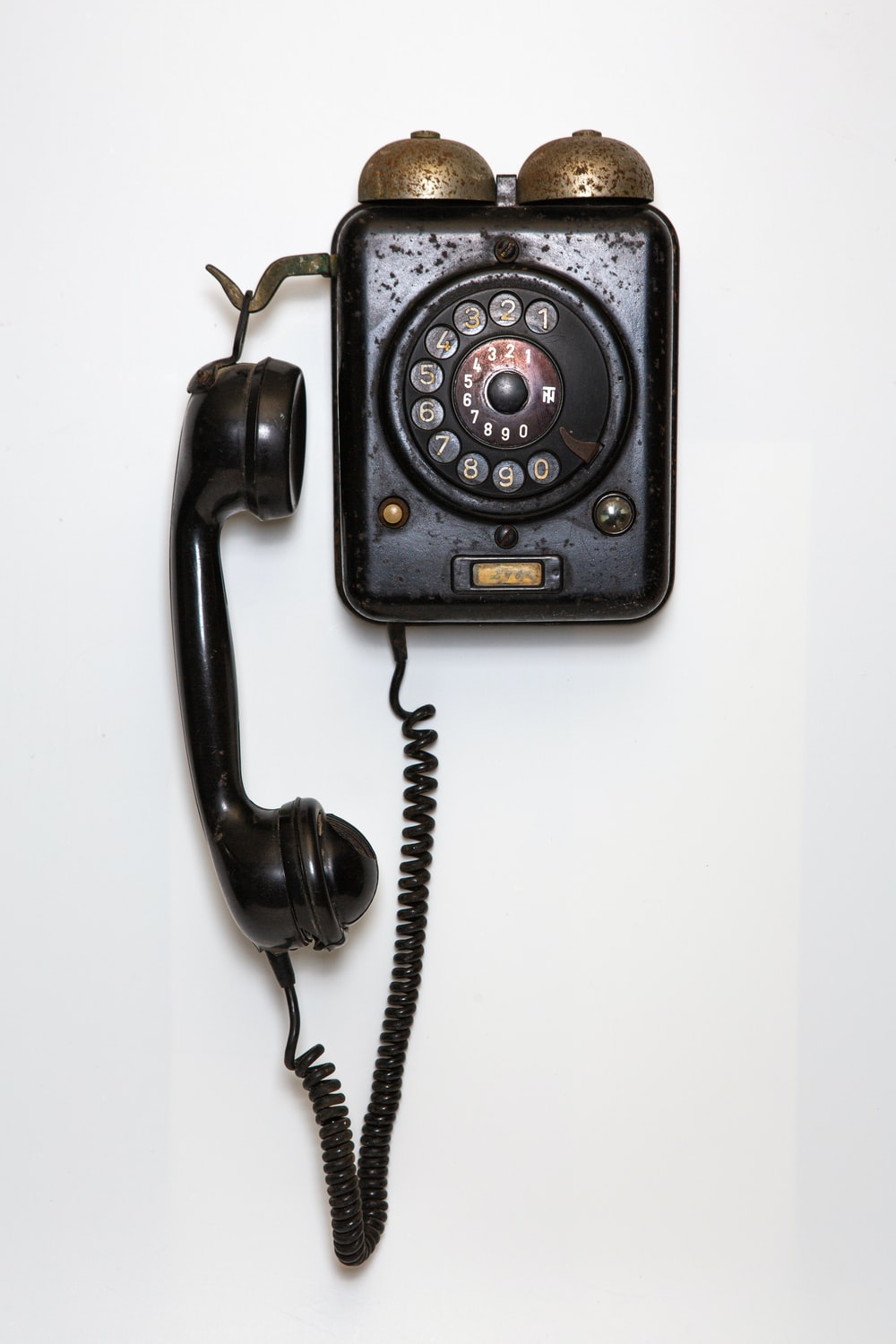 black and gray corded telephone