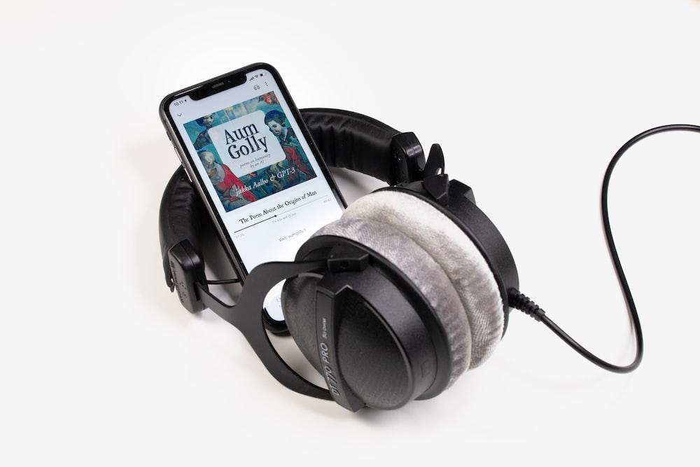 black and gray corded headphones