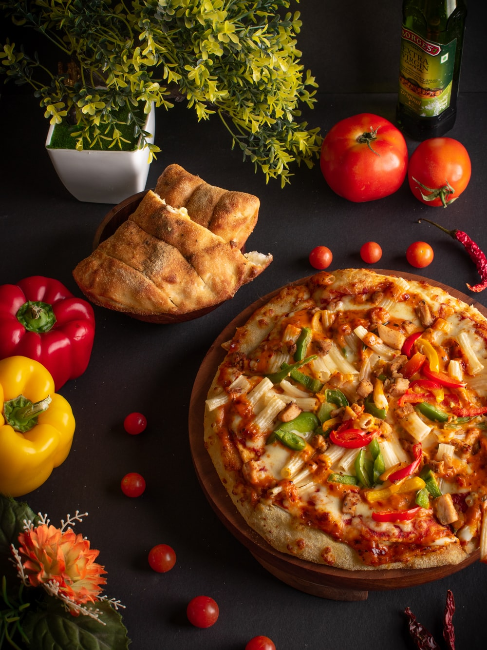 pizza with cheese and tomatoes on brown wooden round plate