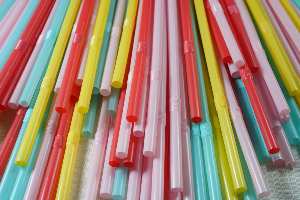 pink green and yellow plastic straw lot