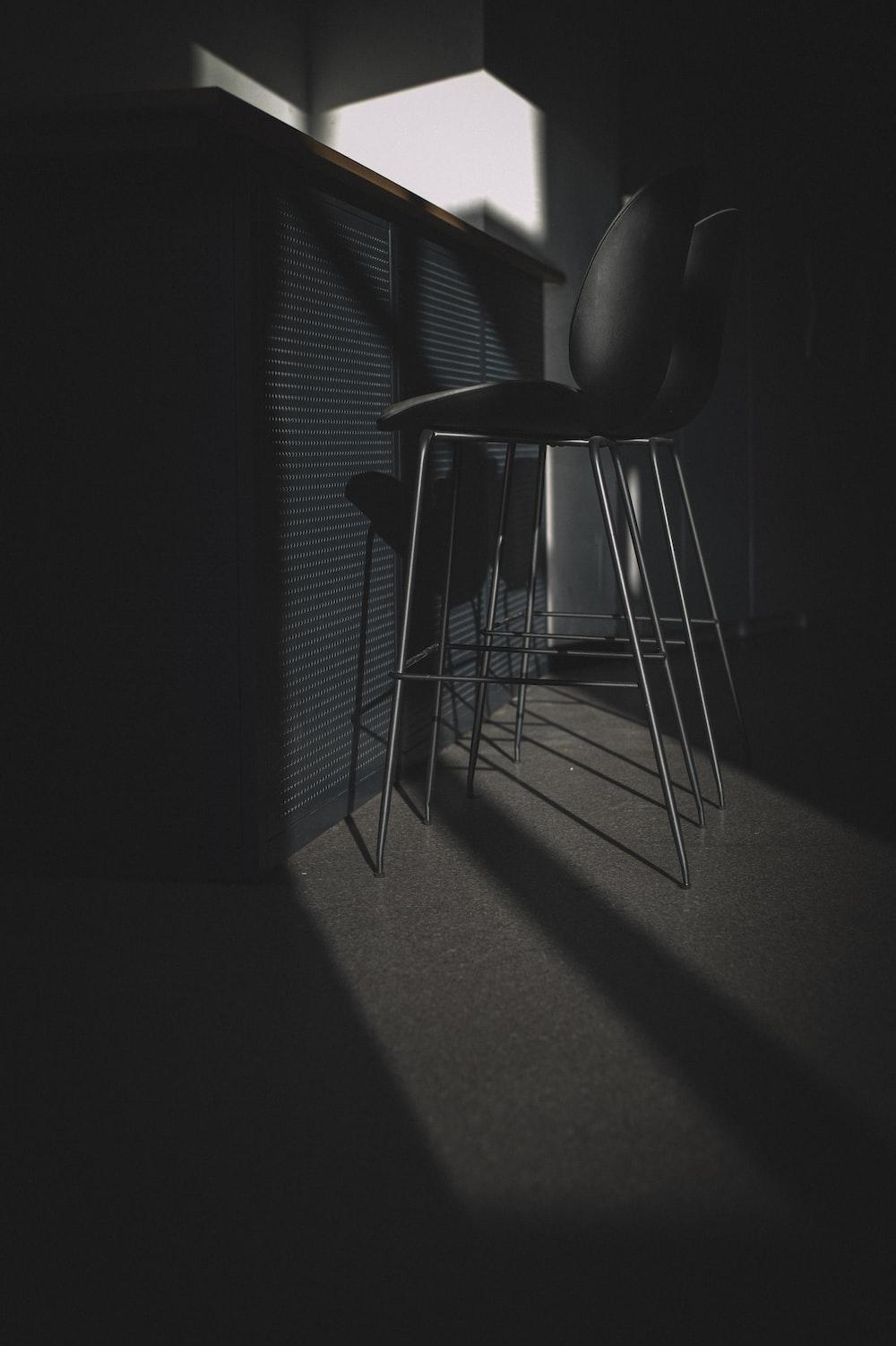 black leather padded chair near window