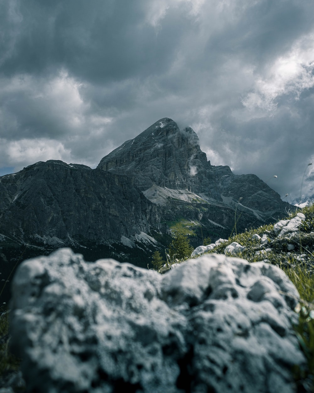 gray rocky mountain under white cloudy sky during daytime