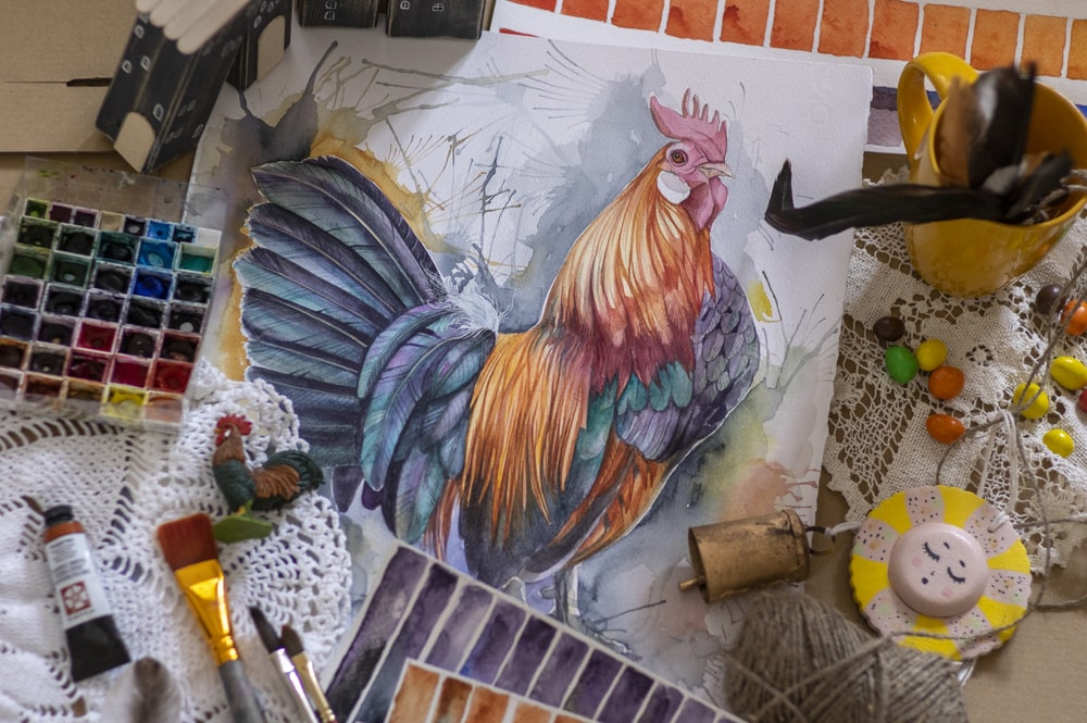 red yellow and blue rooster painting