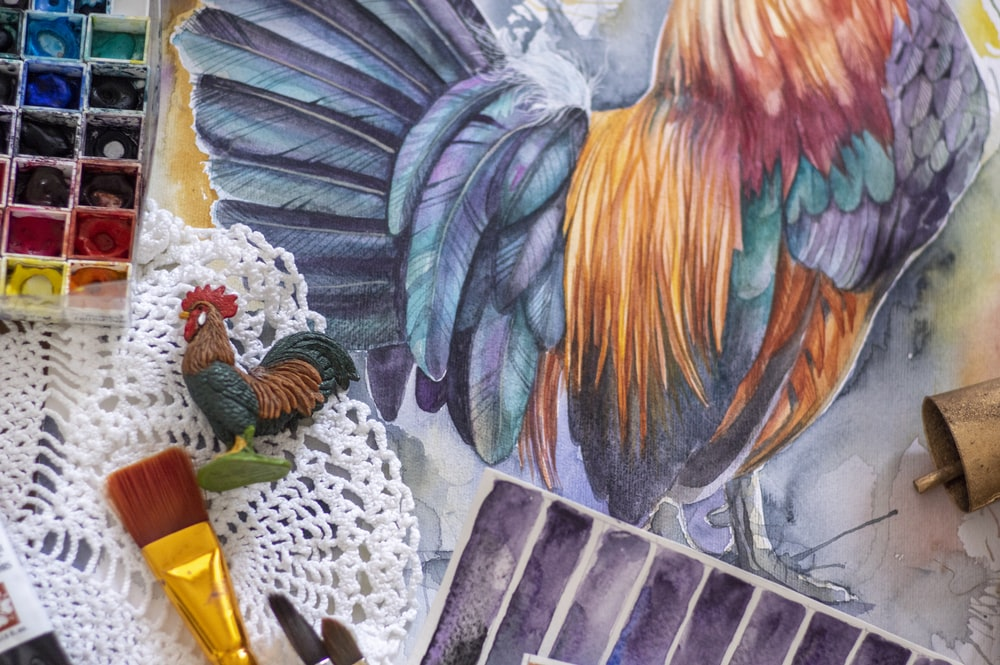 blue yellow and red rooster painting