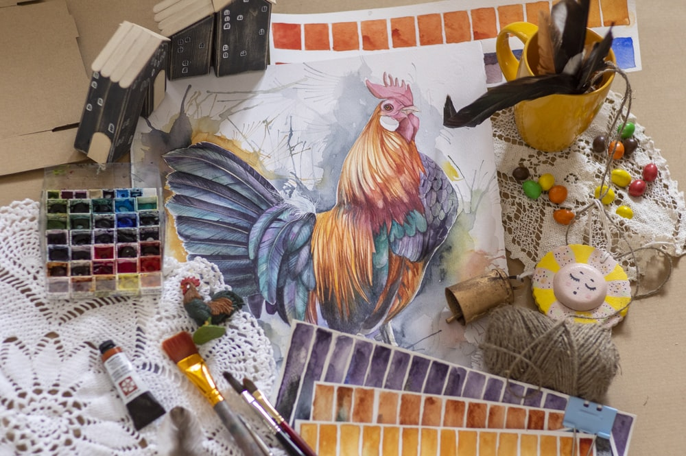 rooster and chicken painting on white wall