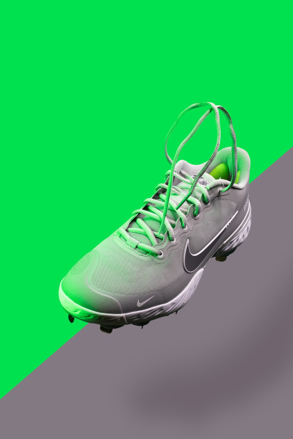 green and white nike athletic shoe