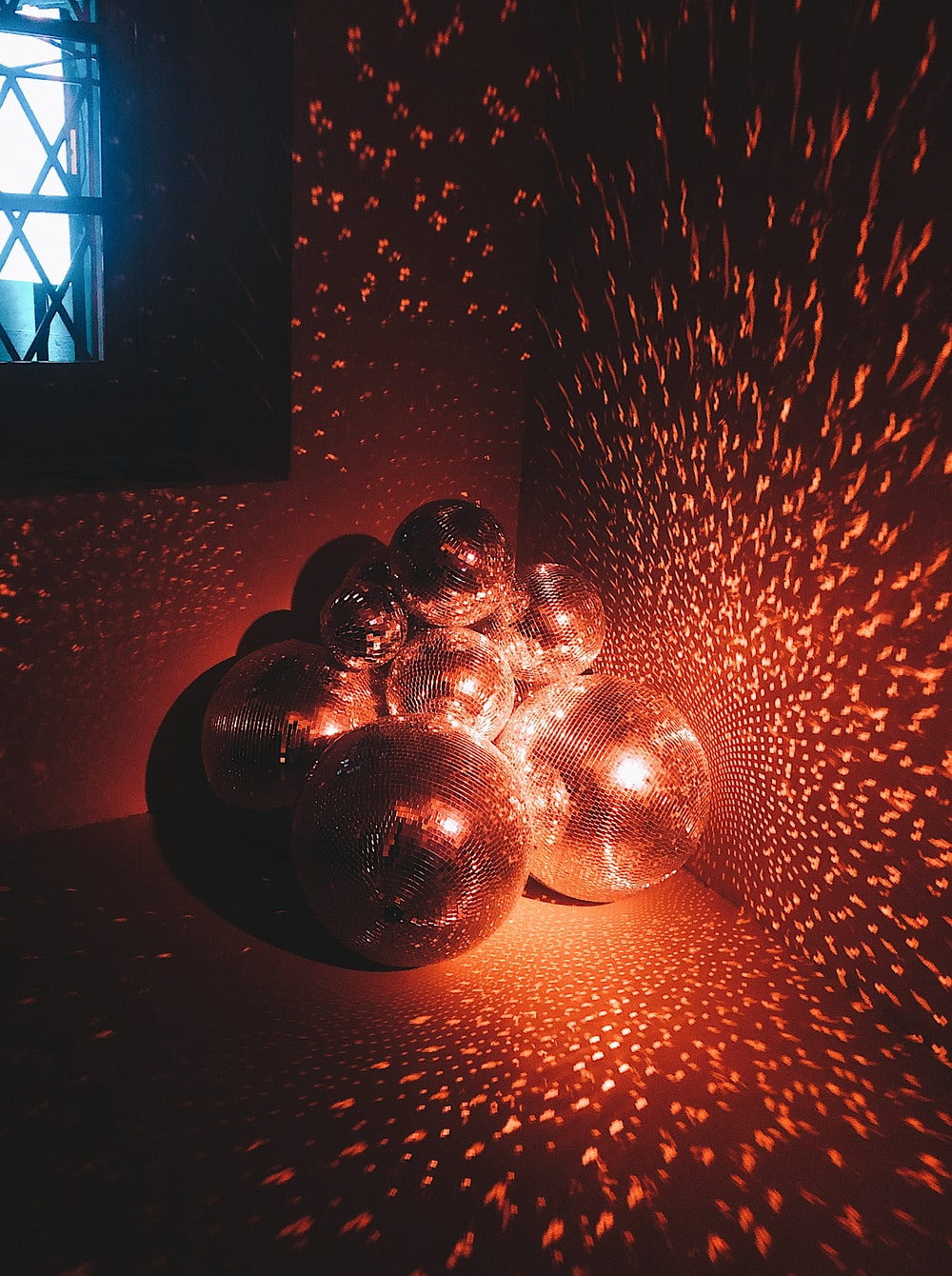 silver baubles on red wall