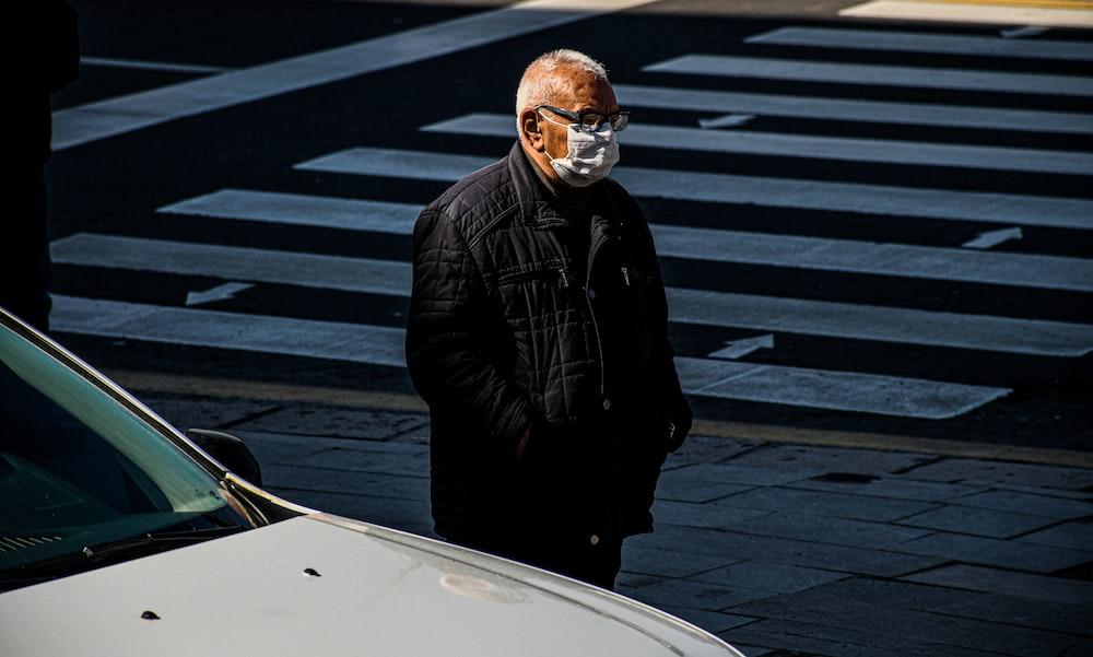 man in black jacket wearing white goggles