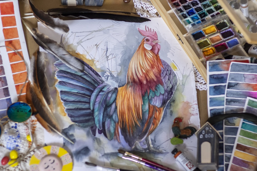 yellow red and blue rooster painting