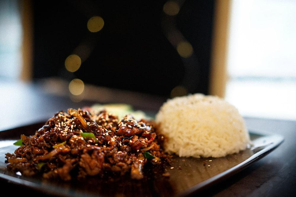 white rice on black ceramic plate
