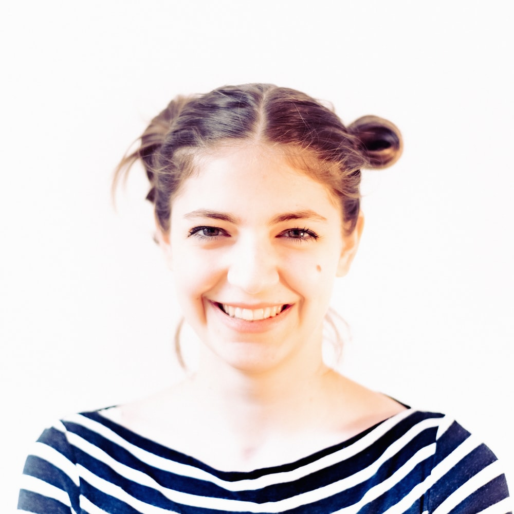woman in black and white striped shirt smiling