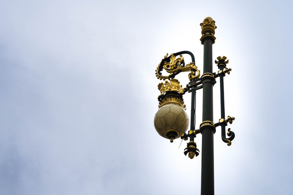 white and gold street lamp