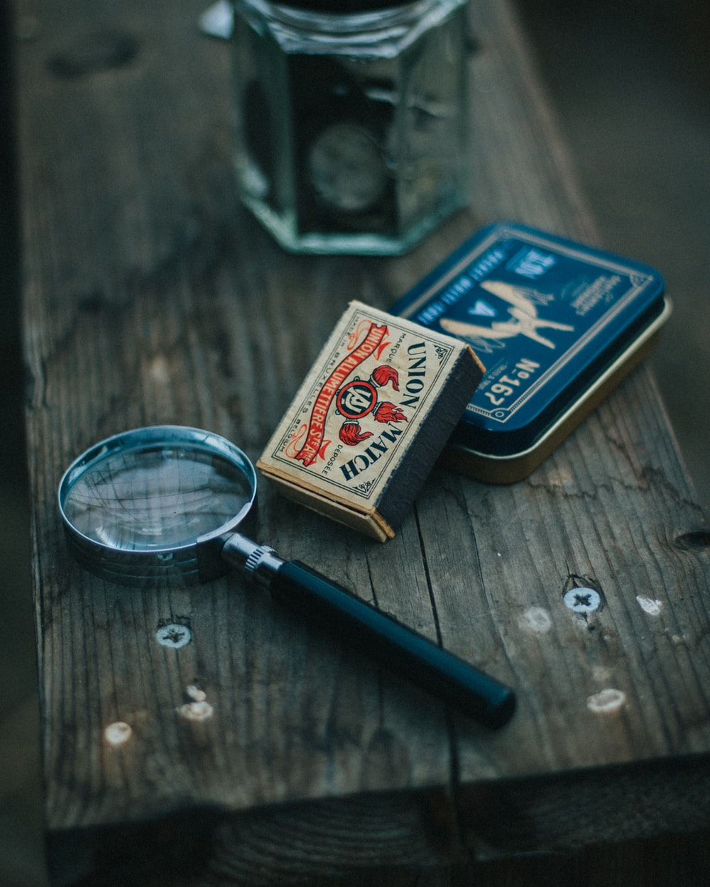 blue magnifying glass on brown wooden table