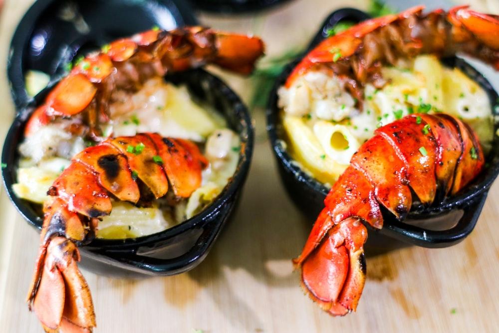 cooked shrimp on black ceramic bowl