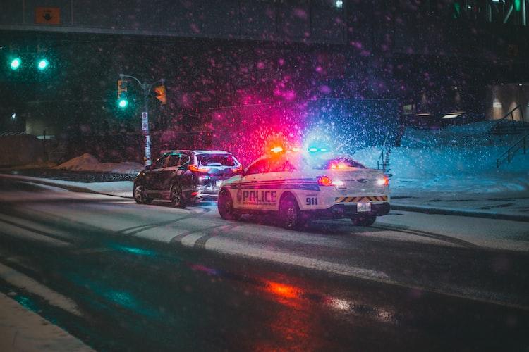 Voiture de Police.   Photo : Unsplash