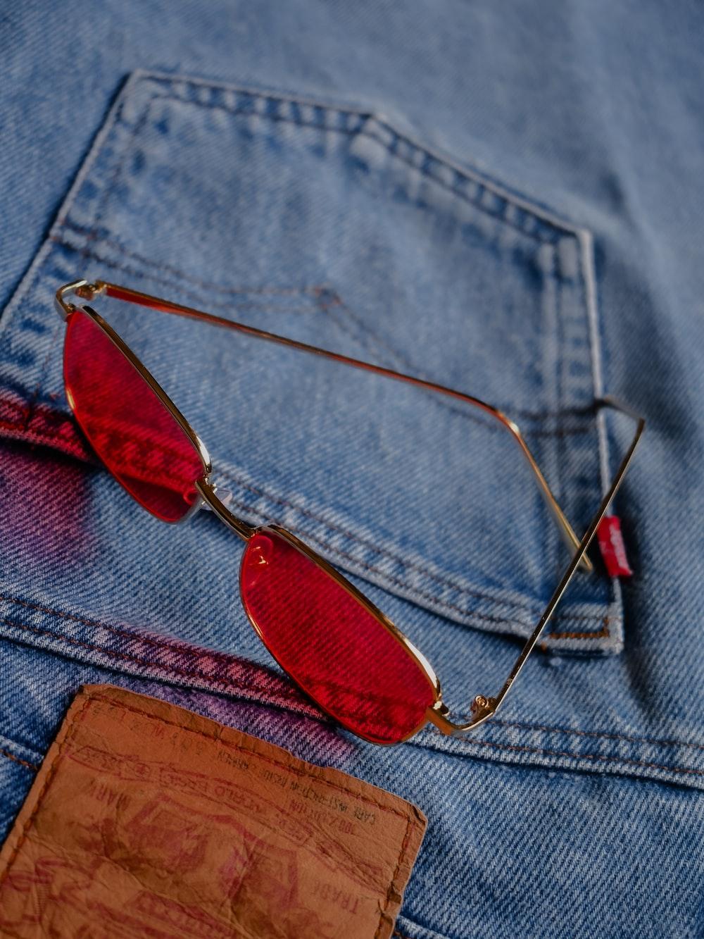 silver framed sunglasses on blue denim textile