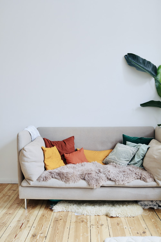 orange throw pillows on white couch