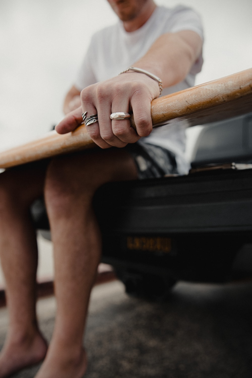 person holding brown wooden bar