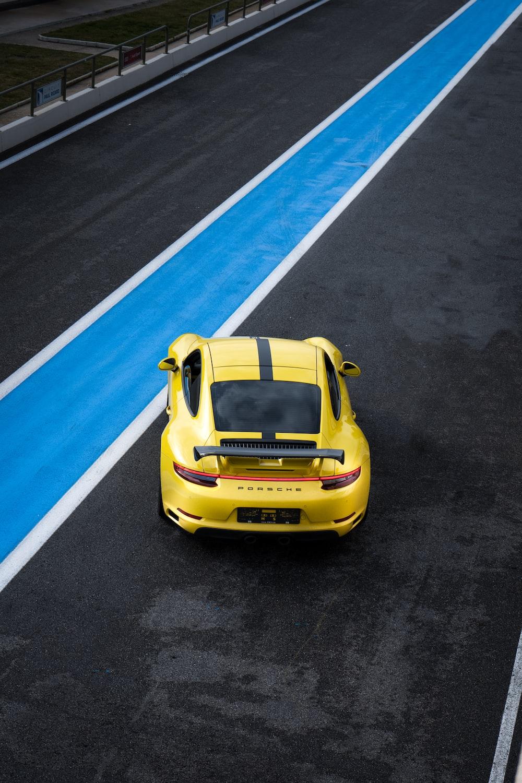yellow porsche 911 on road