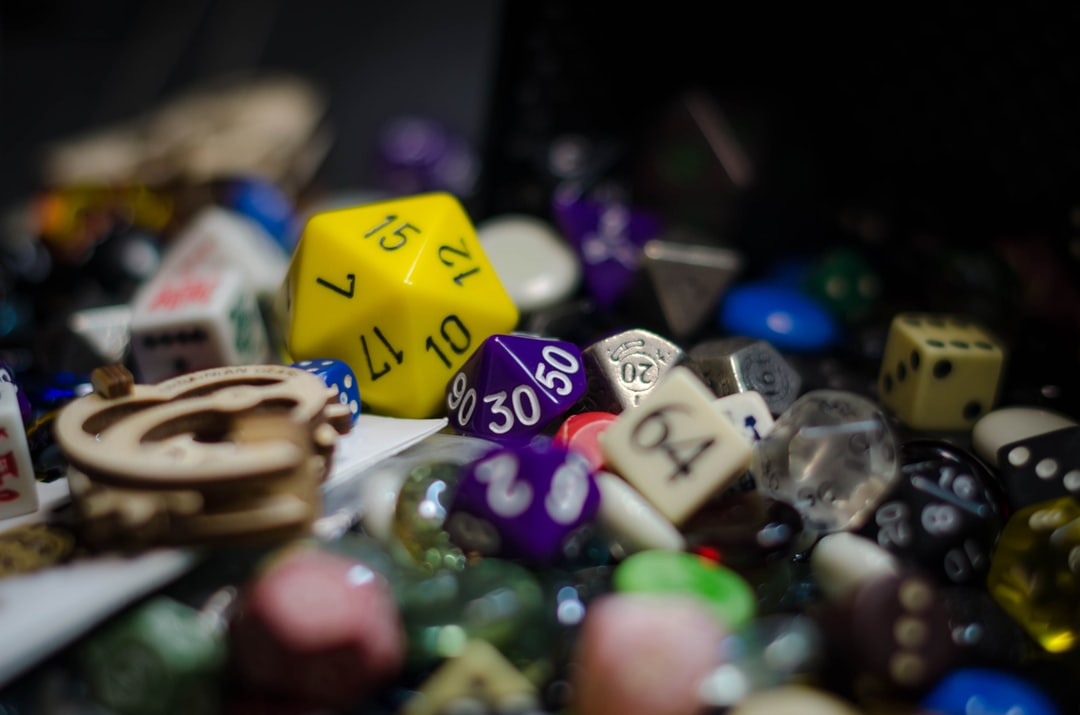 yellow and white dice with numbers