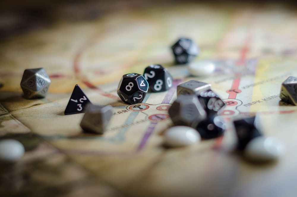 black and white dice on brown wooden table
