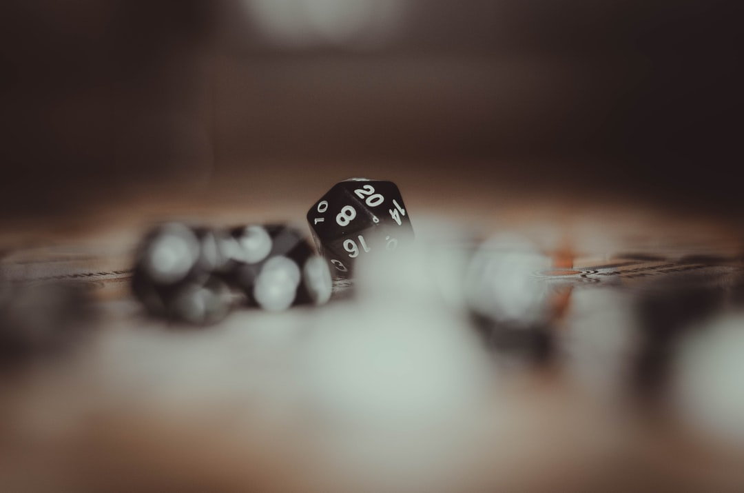 white and black dice on brown wooden table