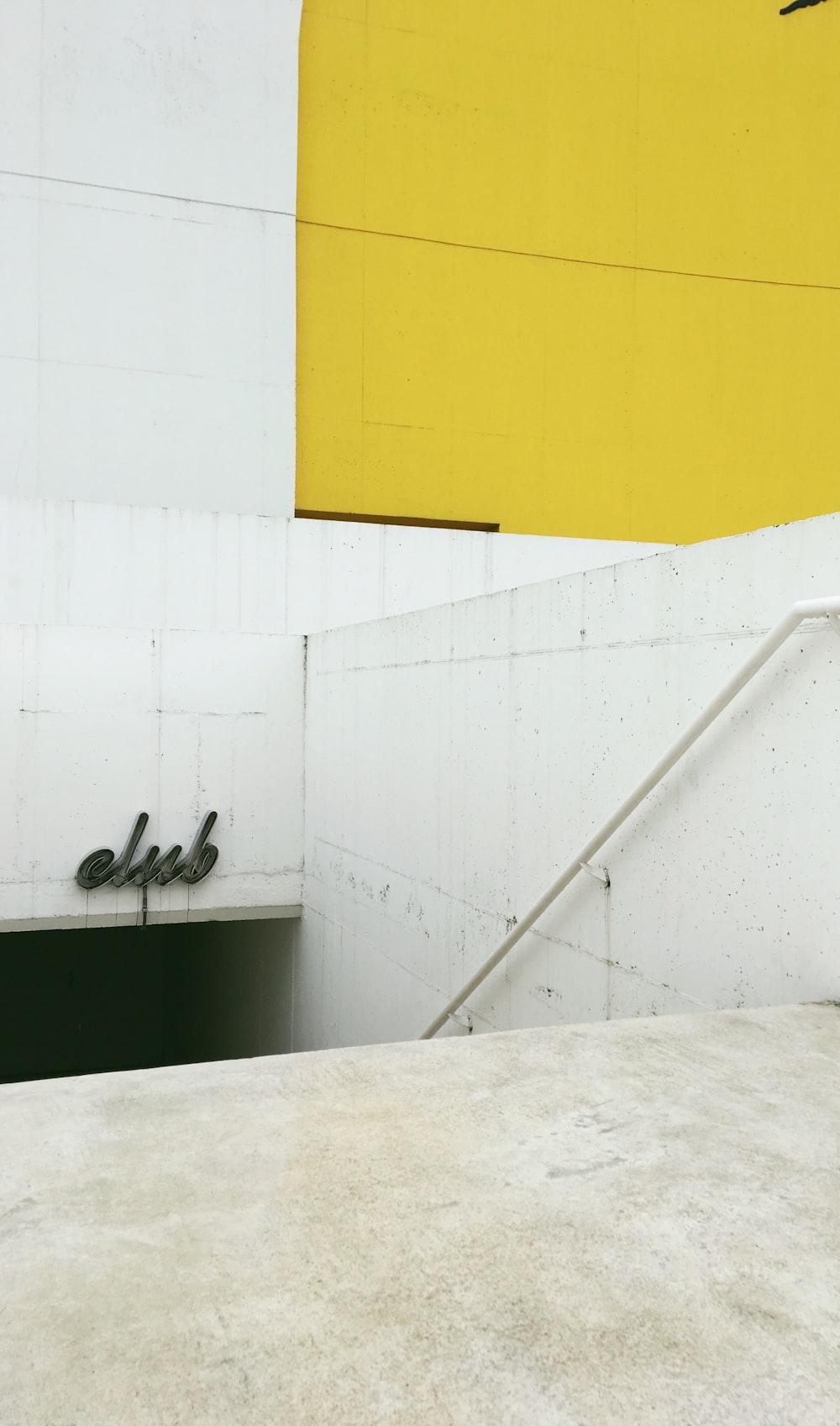 white and yellow concrete staircase
