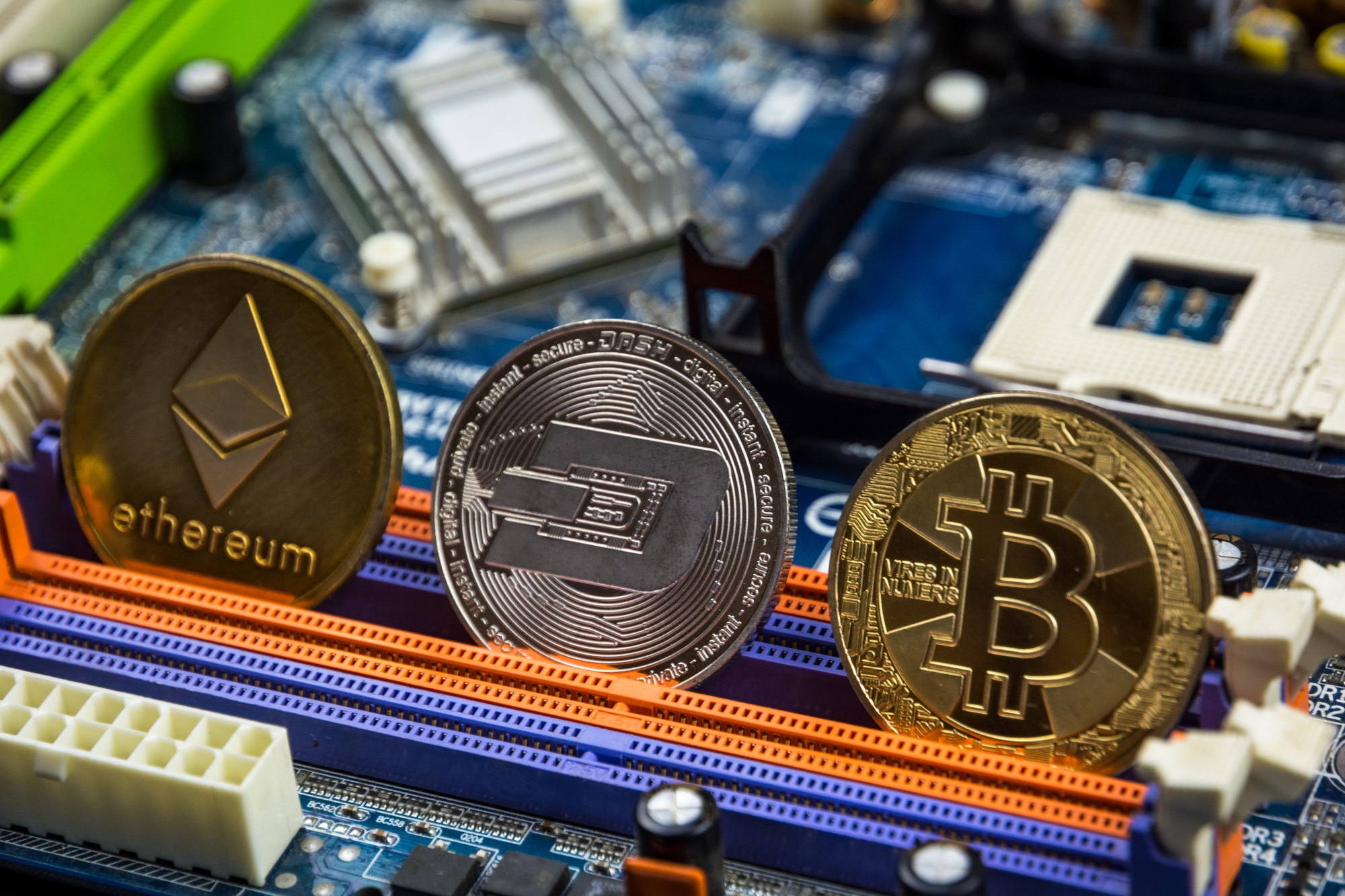 Bitcoin, Etherium, Dash coin and motherboard