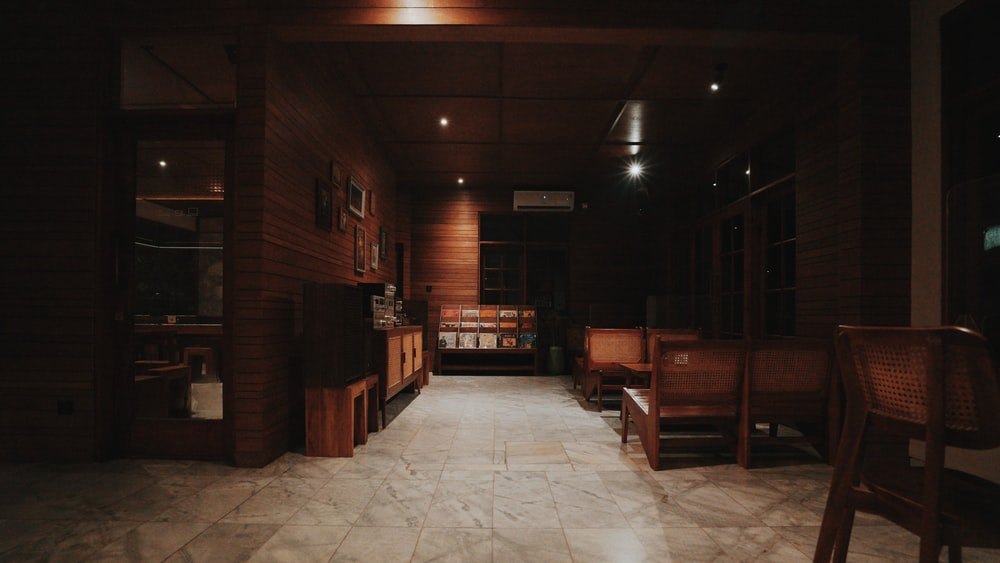 brown wooden chairs and tables in room